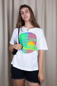 the model wears a white tee with a bahamas graphic