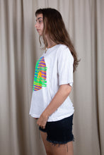 Load image into Gallery viewer, the model wears a white tee with a bahamas graphic