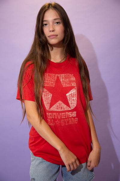 Red in colour, this single stitch tee has a faded print on the front of 'All Star Converse' and the shoe company's logo above it. On the back, Converse is printed across.