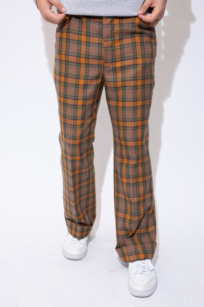 Soft orange, brown and green plaid pants in a straight leg with belt loops, pockets, folded rims and a closing clasp.