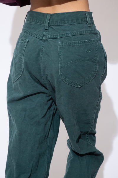 the model wears a pair of forest green jeans
