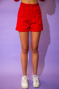 the model wears a pair of red cotton shorts
