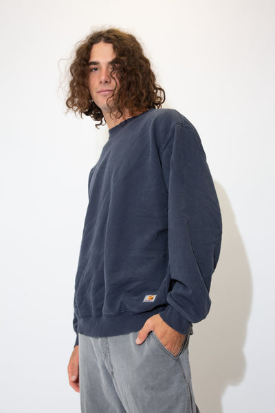 hamish wears a distressed navy carhartt sweater