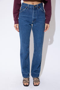 Dark-wash blue jeans in a straight leg fit with yellow stitching, belt loops, plenty of pockets and Lee branding on the button, domes, back waistline and back pocket.