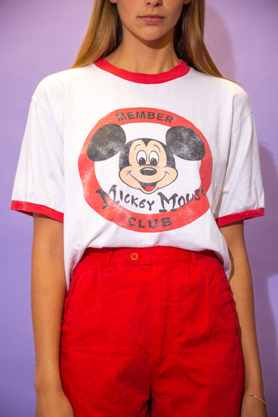 the model wears a mickey mouse ringer tee