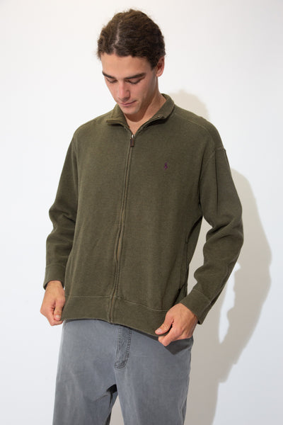Soft olive green sweater with a full-length zip with a brown leather full-length zip and a purple Ralph Lauren logo embroidered on the left chest.