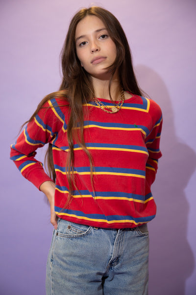 Red long-sleeved tee in a crew neck style horizontally striped in blue and yellow. Finished off with an embroidered green Ralph Lauren logo on the left chest