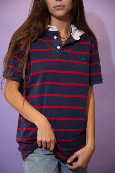 Navy blue rugby style tee with red horizontal stripes, a white collar and matching white buttons. Finished off with a green embroidered Ralph Lauren logo on the left chest.