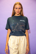 Load image into Gallery viewer, the model wears a black tee with an arizona graphic on the front