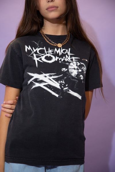Black in colour, this tee has a large white print on the front repping My Chemical Romance along with a skeleton marching band, a clock and scratches.