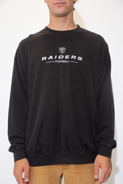 Black in colour, this jumper has a white and grey 'Raiders Football' embroidered spell-out across the front with the team's logo above.