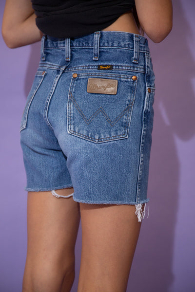 Mid-wash blue denim shorts in a midi-length fit with distressed rims and branding on the button, back pocket and back stitching.