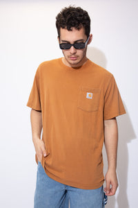the model wears an orange carhartt tee