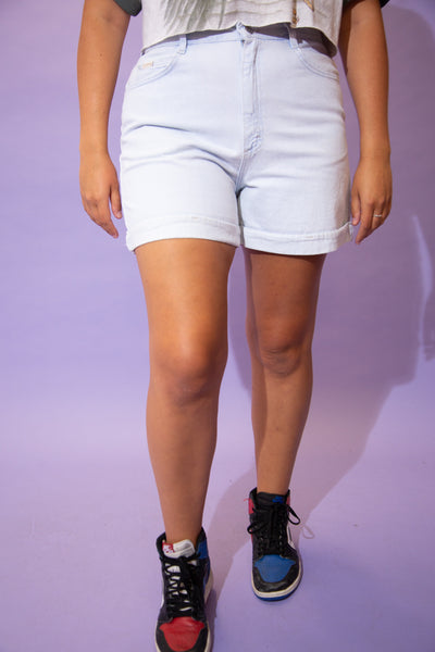the model wears a super light washed pair of riders denim shorts