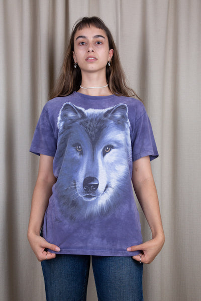 the model wears a purple tie dye tee with a wolf graphic