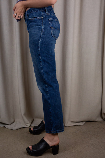 the model wears a pair of dark wash blue tommy jeans