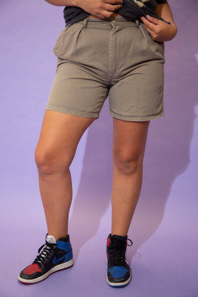 the model wears a pair of polo ralph lauren khaki shorts
