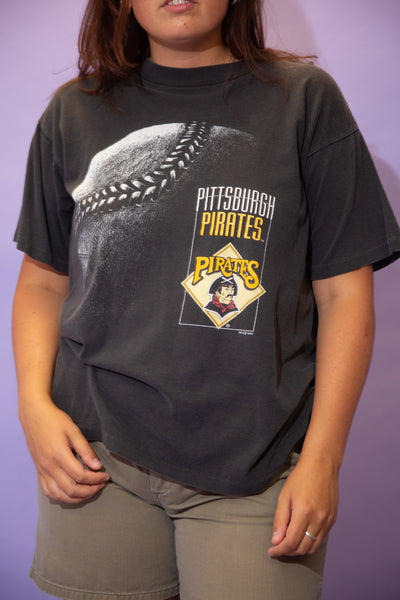 the model wears a faded black tee with a pittsburgh pirates graphic on the front