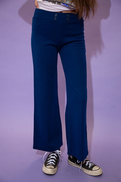 Soft in feel, these flared pants are royal blue in colour with lil buttons on the adjustable waistline.