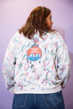 Load image into Gallery viewer, This cosy oversized sweater is faded white in colour with various coloured paint splatters and spreads across the jumper. 'The Sherwin Williams CO.' is printed on the left chest pocket and 'Cover The Earth' printed on he back in the company's logo.