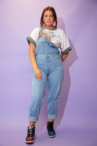 Light wash blue, these dungarees are in a straight leg fit with light brown stitching, a front chest pocket, side pockets, folded bottoms and branded buttons.