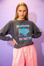 Load image into Gallery viewer, the model wears a grey sweater with a rock n roll spell out graphic on the front