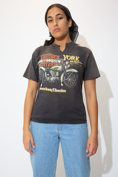 the model wears a fitted harley davidson tee