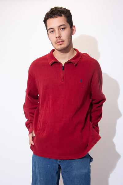 Soft maroon coloured sweater in a quarter-zip style with a navy blue embroidered Ralph Lauren logo on the left chest for a chill fit!