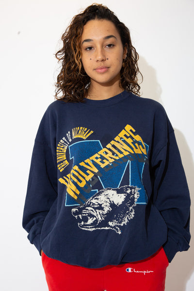model wears a navy wolverines nfl sweater