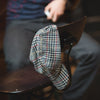 Walz Velo City Cap Plaid hanging on a chair