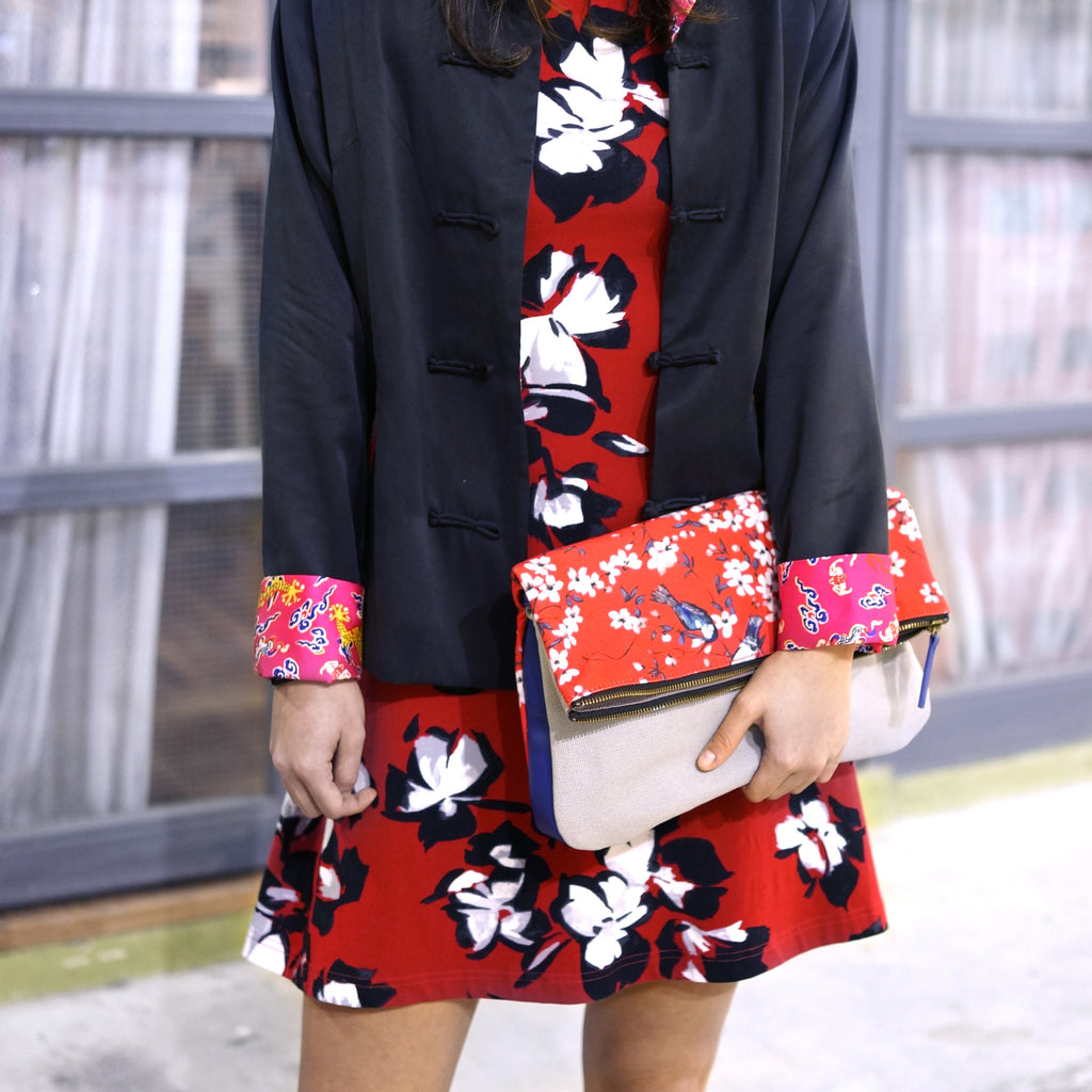 'Cherry Blossom' clutch with leather trim | Goods of Desire