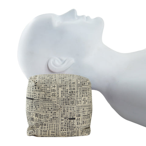 'Newspaper' myrobalan leaf-filled neck pillow