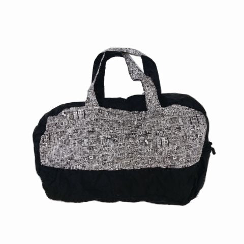 'Newspaper' foldable duffle