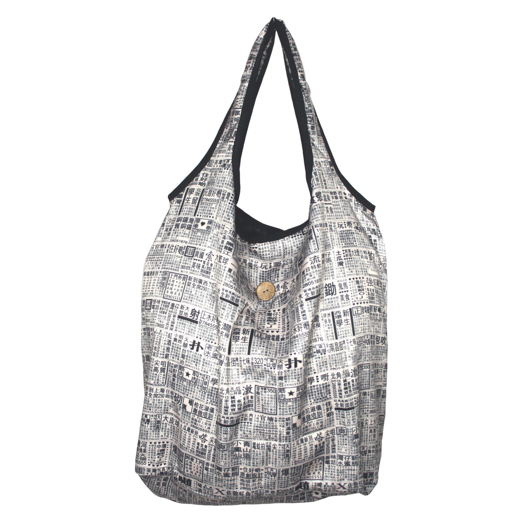 'Newspaper' foldable shopping bag with button