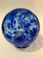 This beautiful blue glass storage bank for wishes, dreams, blessings, and thoughtful ideas includes a notepad of 52 slips of paper on which your treasured thoughts can be recorded and inserted into the wishing ball (or gratitude ball) for safe keeping. Footed glass ball measures approximately 3 and one-half inches in diameter.