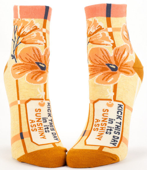 "Woman's novelty fun ankle sock with legend: ""Kick This Day In Its Sunshiny Ass"""