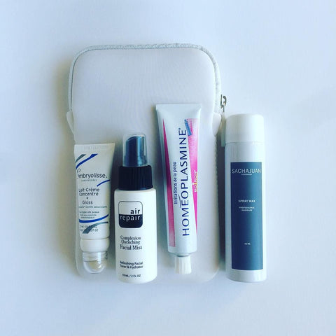 White travel bag with Embryolisse, Air Repair Skin care, homeoplasmine and Sachajuan hair care from OFFEN