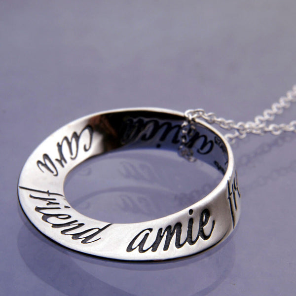 Friend In Ten Languages Mobius Necklace