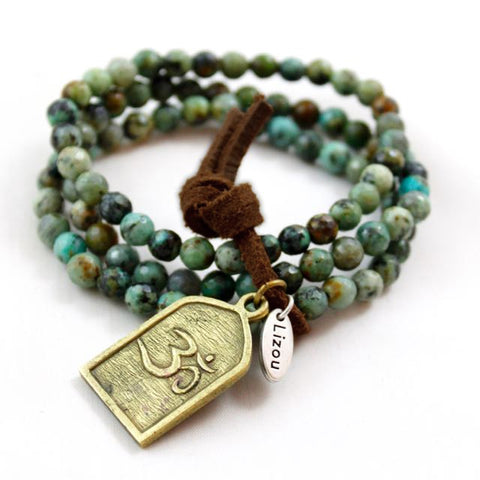 LizouTurquoise Bracelet With Charm Showing Om Symbol