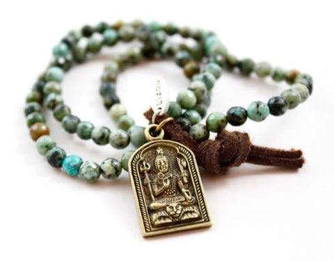 LizouTurquoise Bracelet With Charm Showing Buddha