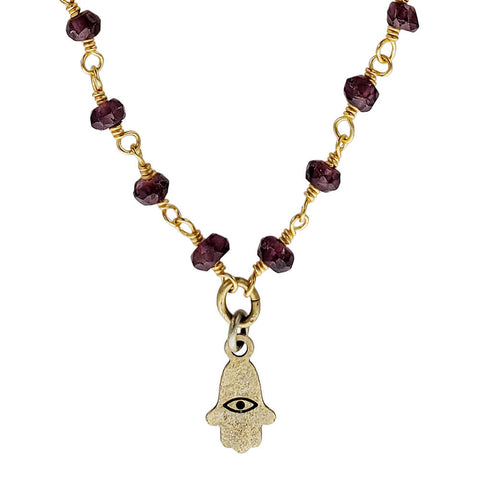 Michal Golan Tiny Garnet Hamsa Necklace Up Close