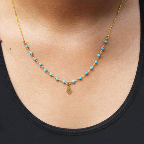 Michal Golan Tiny Turquoise Hamsa Necklace Being Worn