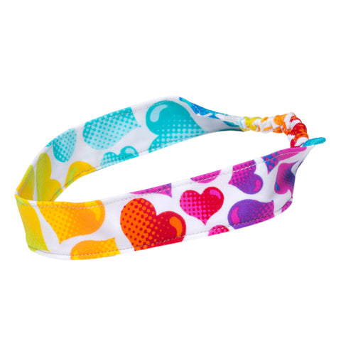 Baby girl headband with cute heart pattern by FASTEN. Heart headband also fits toddlers and school age girls.