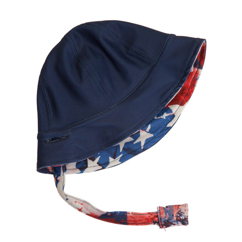 Reversible toddler hat by FASTEN. Cute American print with stars. Solid indigo hat. Magnetic chin strap to keep on head. Unisex hat can be worn by toddler boys and girls.