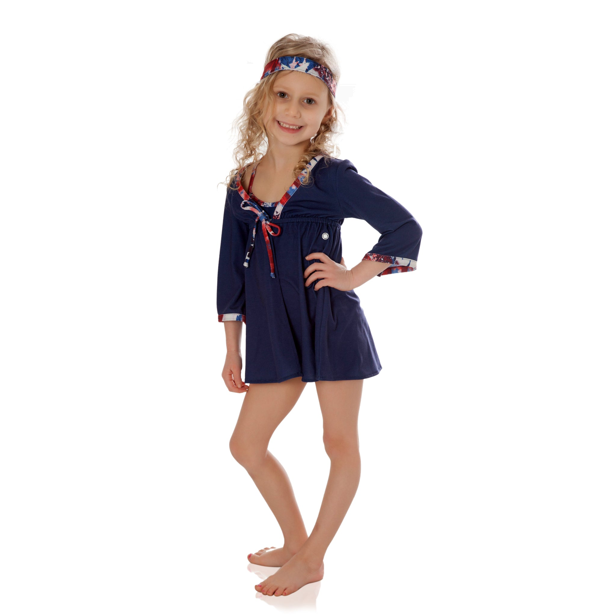 Keep your little girl protected from the sun with this FASTEN UPF 50 girl cover up. Features magnetic tie-front closure. Indigo cover up with Americana trim. Red, white and blue beachwear. Great for 4th of July or Memorial Day!