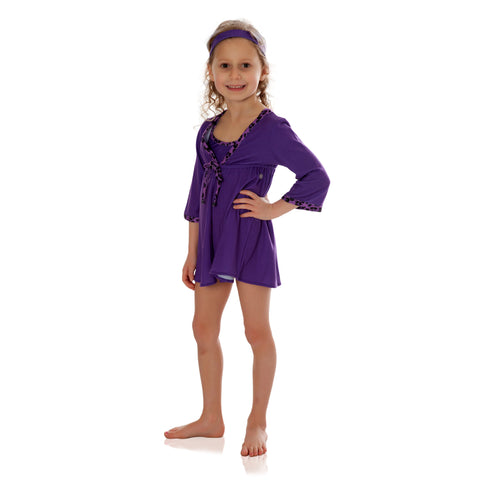 UPF 50+ cover up for toddlers and young girls by FASTEN Swimwear. Purple cover up with purple cheetah trim. Great sun protection for beach and pool days! Magnetic closure at front.