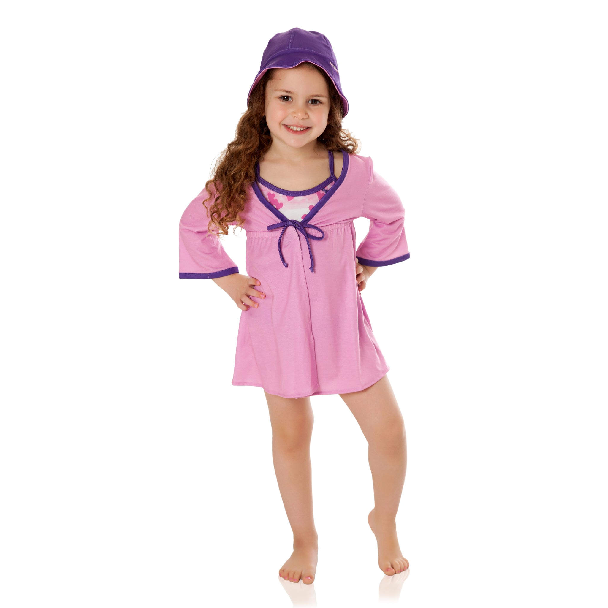FASTEN girls cover up with UPF 50+ sun protection. Rose with Purple tie-front cover up features magnetic closure. Kids beachwear. Coordinates with FASTEN swimsuits. Toddler girl swimwear. Sizes XS-L.