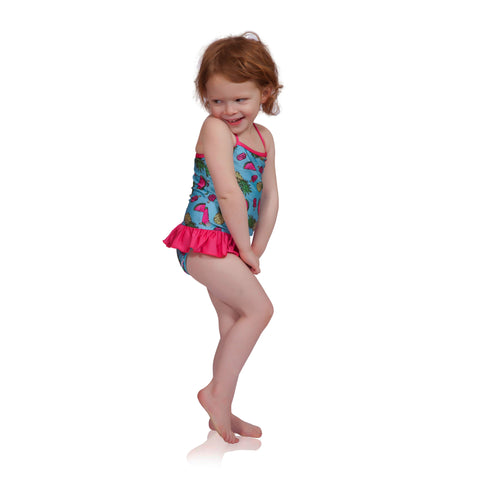 FASTEN swimsuit, Fruitsicle cross-back swimsuit with ruffle for baby and toddler girls. Features patented design that opens at the waist, making bathroom breaks and baby diaper changes faster and easier. Sizes 6m-5. UPF 50 sun protection built right in! Cross-back swimsuit design. Cute fruit pattern with ruffle.