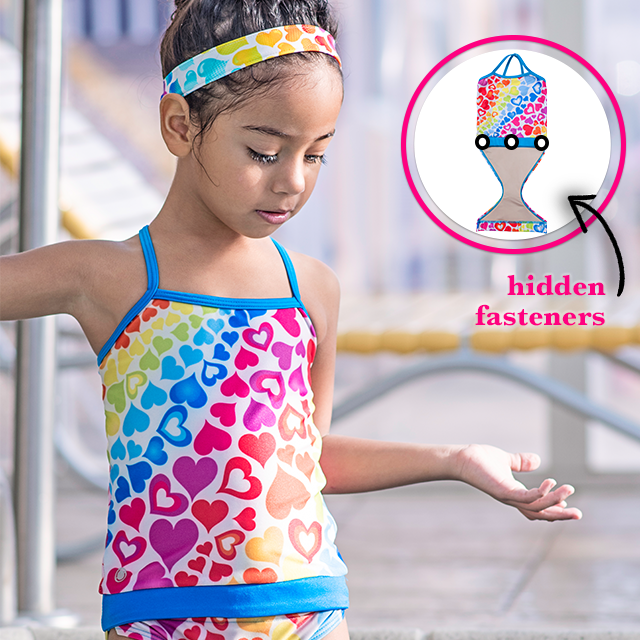 0d3ae1e5f9 ... Young girl at pool wearing FASTEN rainbow hearts swimsuit for girls.  Sizes 6m - ...