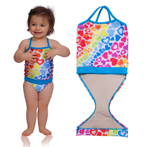 FASTEN rainbow hearts swimsuit for girls. Sizes 6m - 5. UPF 50 sun protection. Patented design that opens at the waist, making diaper changes and bathroom breaks faster and easier. Perfect for potty training! Cross-back design with hearts pattern.